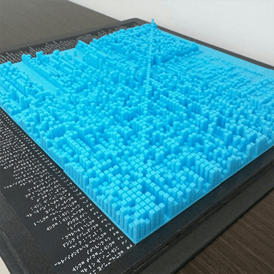 Blue 3D-printed heatmap, similar to a geographical model, representing values with height.